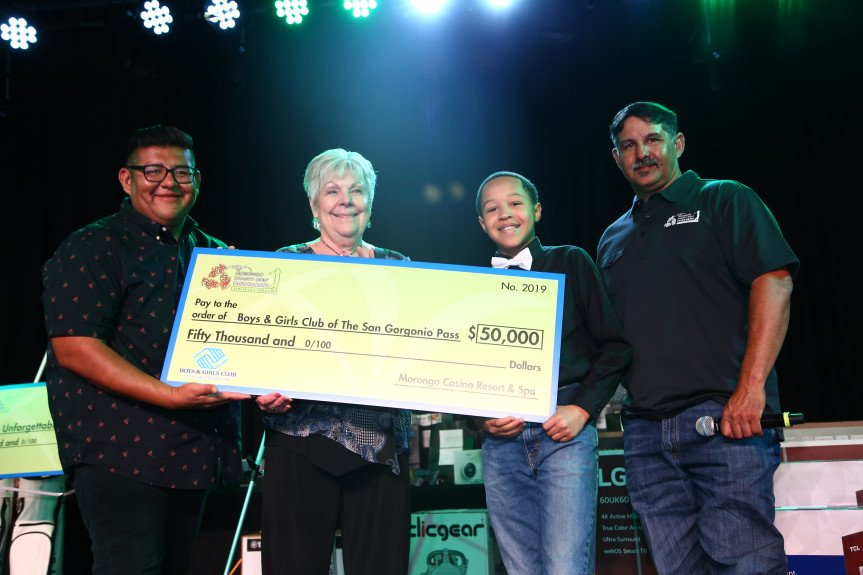 Morongo Vice Chair James Siva, left, and Tribal Council Member Brian Lugo, far right, present a $50,000 check to Boys & Girls Clubs of the San Gorgonio Pass Board President Linda Hanley